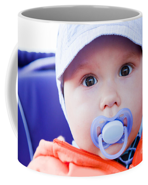 Child Coffee Mug featuring the photograph Young Baby Boy With A Dummy In His Mouth Outdoors by Michal Bednarek
