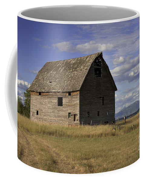 Big Sky Coffee Mug featuring the photograph Old Big Sky Barn by Sandra Bronstein