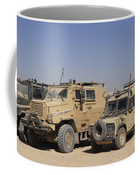 4x4 Coffee Mug featuring the photograph A British Armed Forces Snatch Land by Andrew Chittock