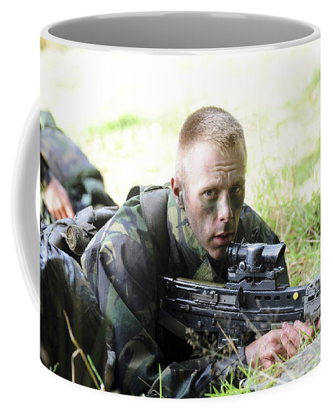 United Kingdom Coffee Mug featuring the photograph A British Soldier Armed With A Sa80 by Andrew Chittock