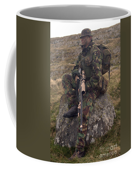 Wales Coffee Mug featuring the photograph A British Soldier Armed With A Sniper by Andrew Chittock