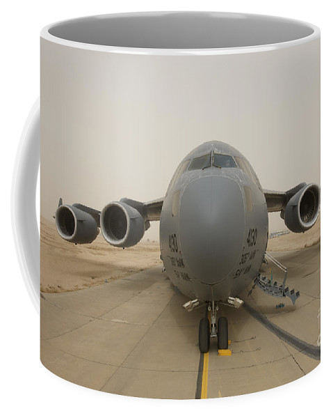 Aviation Coffee Mug featuring the photograph A C-17 Globemaster IIi Sits by Terry Moore