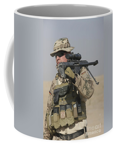Weapon Coffee Mug featuring the photograph A German Soldier Carries A Barrett by Terry Moore