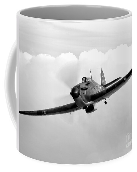 Black And White Coffee Mug featuring the photograph A Hawker Hurricane Aircraft In Flight by Scott Germain