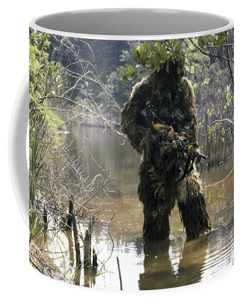 Three Quarter Length Coffee Mug featuring the photograph A Sniper Dressed In A Ghillie Suit by Stocktrek Images