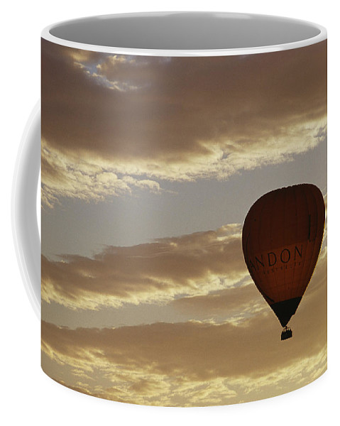 Clouds Coffee Mug featuring the photograph A Soaring Hot Air Balloon by Jason Edwards
