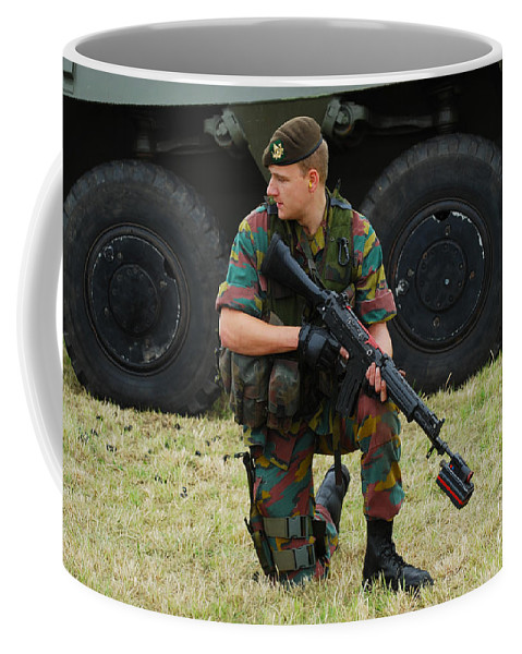 5.56mm Coffee Mug featuring the photograph A Soldier Of An Infantry Unit by Luc De Jaeger