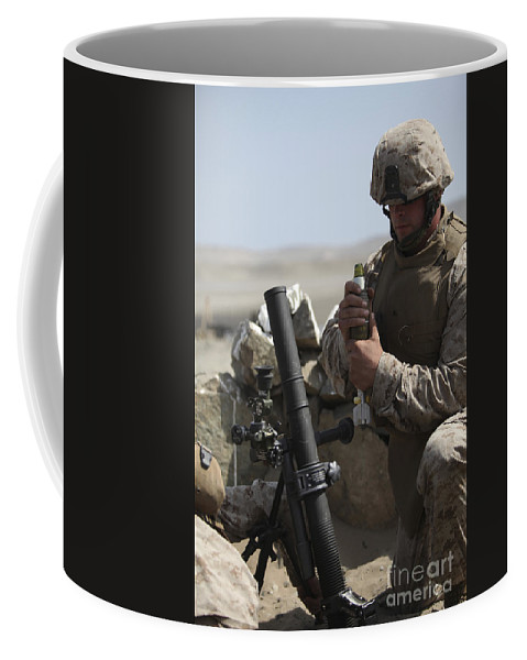 Battle Coffee Mug featuring the photograph A U.s. Marine Loads A Mortar by Stocktrek Images