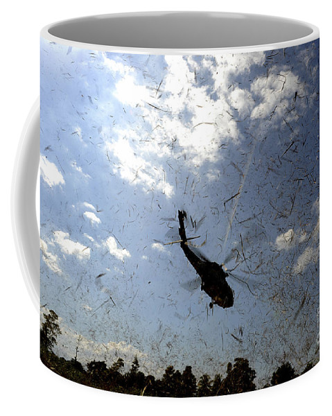 Destruction Coffee Mug featuring the photograph A U.s. Navy Hh-60 Seahawk Stirs by Stocktrek Images
