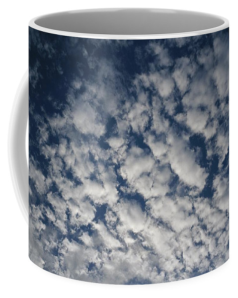 Sky Coffee Mug featuring the photograph A View Of A Cloud-filled Sky Over Miami by Raul Touzon
