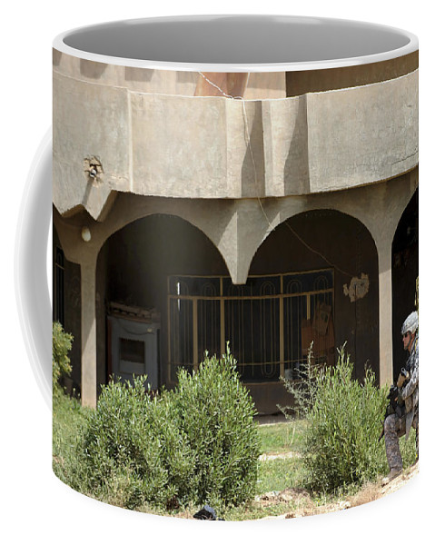 Security Forces Coffee Mug featuring the photograph Airman Conducts Security by Stocktrek Images