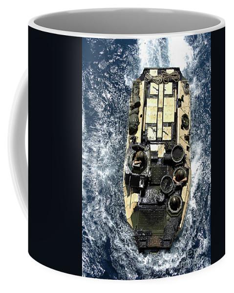 Aav Coffee Mug featuring the photograph An Amphibious Assault Vehicle Navigates by Stocktrek Images