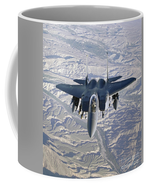 Color Image Coffee Mug featuring the photograph An F-15e Strike Eagle Soars by Stocktrek Images