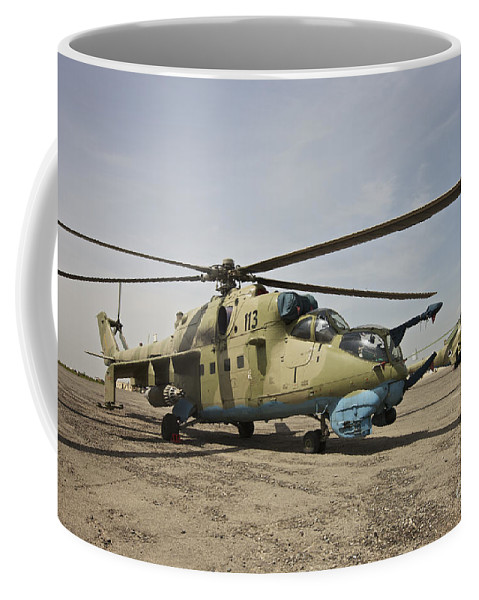 Kunduz Coffee Mug featuring the photograph An Mi-35 Attack Helicopter At Kunduz by Terry Moore