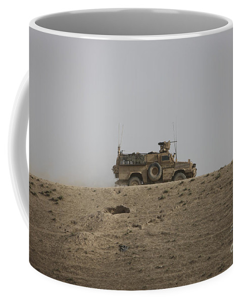 Isaf Coffee Mug featuring the photograph An Mrap Vehicle Patrols The Ridge by Terry Moore