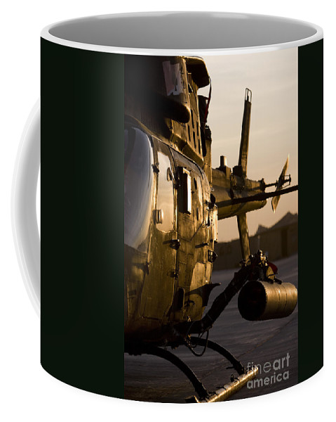 Aviation Coffee Mug featuring the photograph An Oh-58d Kiowa During Sunset by Terry Moore