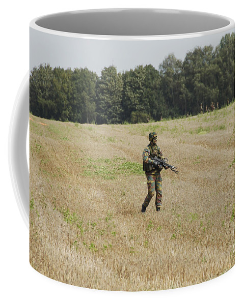 Armed Forces Coffee Mug featuring the photograph Belgian Paratroopers Proceeding by Luc De Jaeger