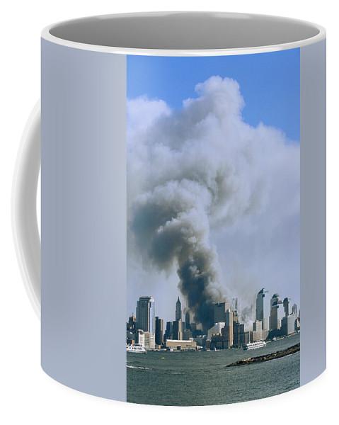 North America Coffee Mug featuring the photograph Smoke Billows Over Manhattan by Steve Winter