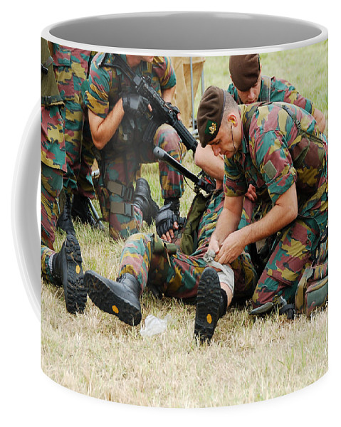 Applying Coffee Mug featuring the photograph Soldiers Of A Belgian Infantry Unit by Luc De Jaeger