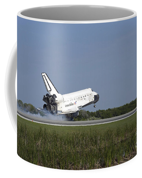 Sts-131 Coffee Mug featuring the photograph Space Shuttle Discovery Lands On Runway by Stocktrek Images