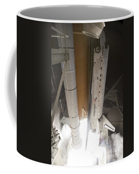 Sts-131 Coffee Mug featuring the photograph Space Shuttle Discovery Lifts by Stocktrek Images