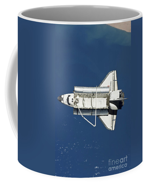 View From Space Coffee Mug featuring the photograph Space Shuttle Discovery by Stocktrek Images