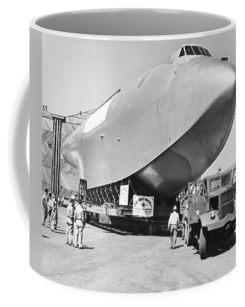 1940's Coffee Mug featuring the photograph Spruce Goose Hull On The Move by Underwood Archives