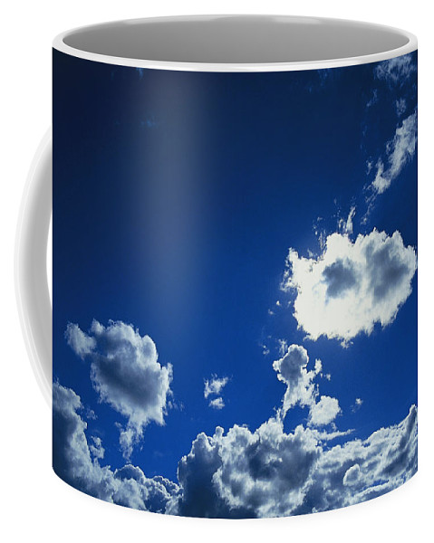 Australia Coffee Mug featuring the photograph Sunlit Fluffy White Clouds In A Blue by Jason Edwards