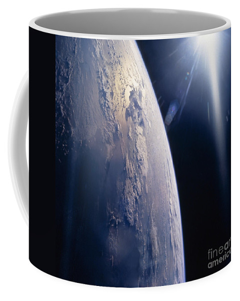 Color Image Coffee Mug featuring the photograph The Sun Shining On Planet Earth by Stocktrek Images