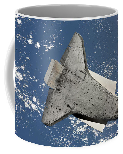 Sts-131 Coffee Mug featuring the photograph The Underside Of Space Shuttle by Stocktrek Images
