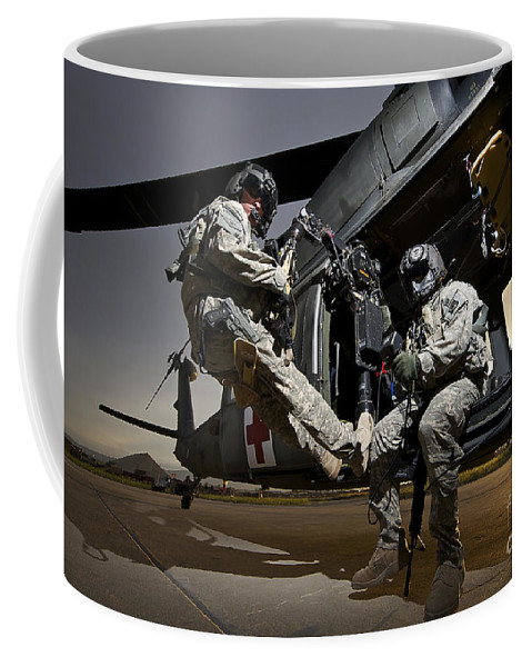 Us Army Coffee Mug featuring the photograph U.s. Air Force Crew Strapped by Terry Moore