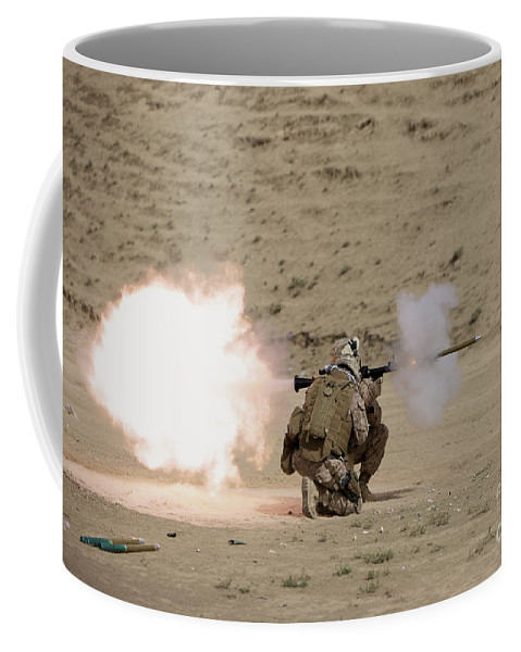 Afghanistan Coffee Mug featuring the photograph U.s. Marine Fires A Rpg-7 Grenade by Terry Moore