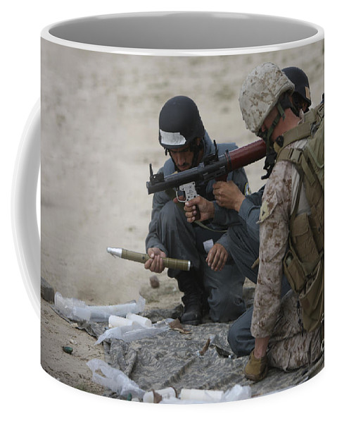 Gun Barrel Coffee Mug featuring the photograph U.s. Marine Watches An Afghan Police by Terry Moore