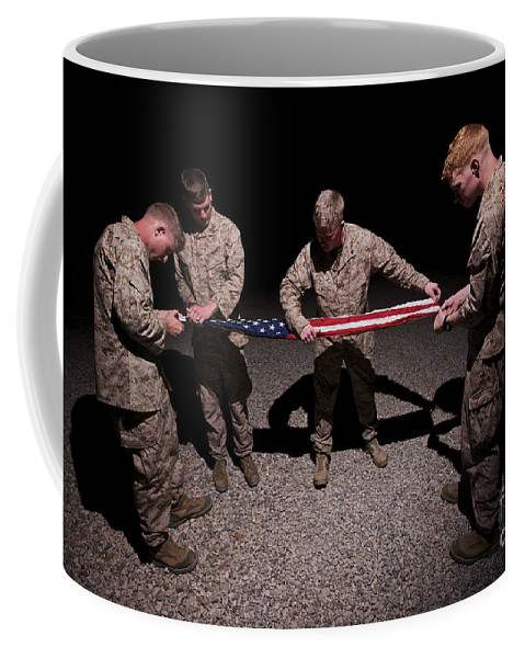 Us Marines Coffee Mug featuring the photograph U.s. Marines Fold The American Flag by Terry Moore