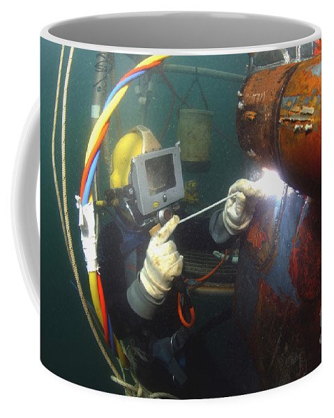 Adults Only Coffee Mug featuring the photograph U.s. Navy Diver Welds A Repair Patch by Stocktrek Images