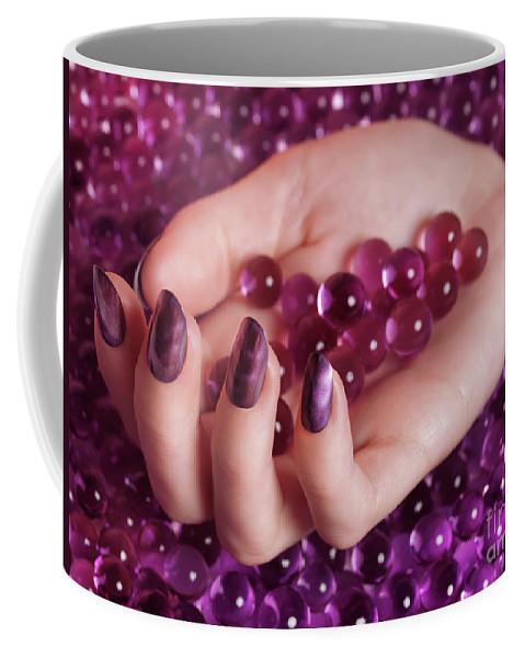 Nail Polish Coffee Mug featuring the photograph Woman Hand With Purple Nail Polish On Candy by Oleksiy Maksymenko
