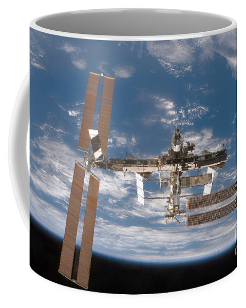 Cloud Coffee Mug featuring the photograph The International Space Station by Stocktrek Images