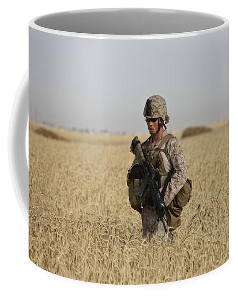 Wheat Coffee Mug featuring the photograph U.s. Marine Patrols A Wadi Near Kunduz by Terry Moore