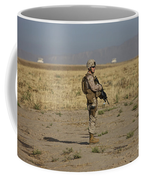 Field Coffee Mug featuring the photograph U.s. Marine Patrols A Wadi Near Kunduz by Terry Moore