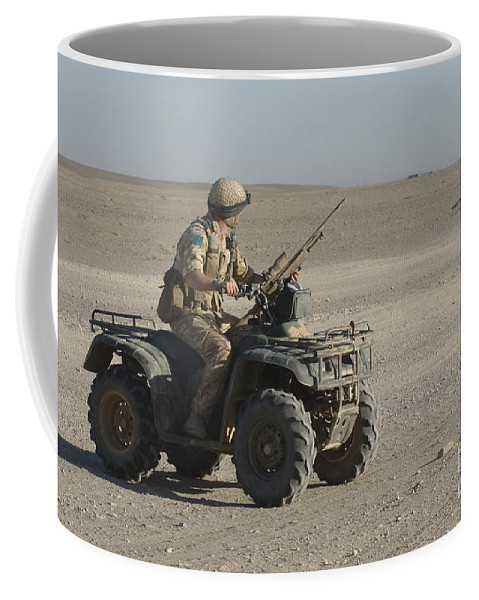 Army Coffee Mug featuring the photograph A British Army Soldier Provides by Andrew Chittock