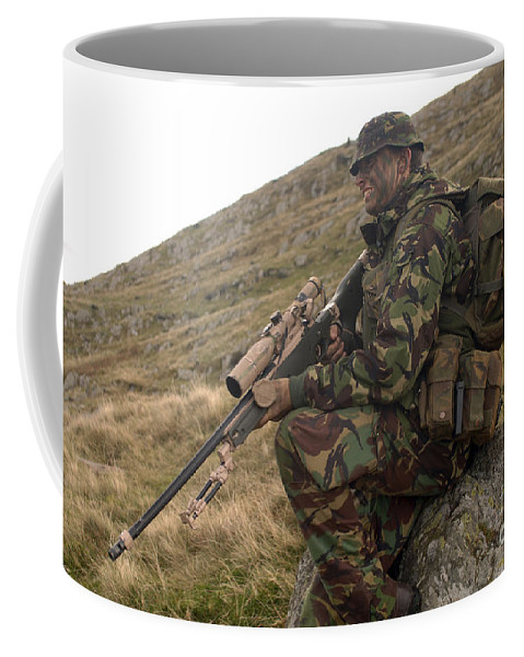 Foreign Military Coffee Mug featuring the photograph A British Soldier Armed With A Sniper by Andrew Chittock