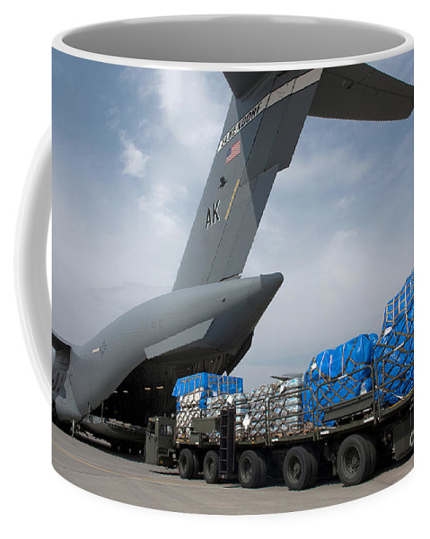 Yokota Air Base Coffee Mug featuring the photograph A Japanese Soldier Marshals Vehicles by Stocktrek Images