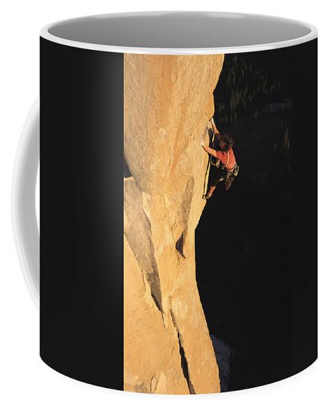 North America Coffee Mug featuring the photograph A Man Rock Climbing On El Capitan by Jimmy Chin