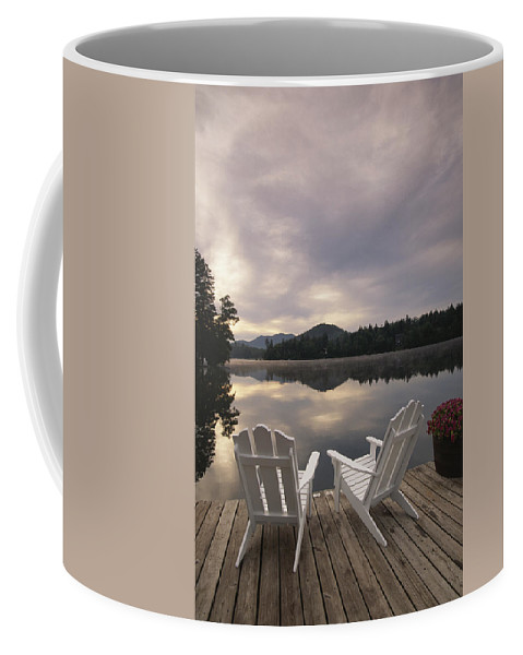 Structures Coffee Mug featuring the photograph A Pair Of Adirondack Chairs On A Dock by Michael Melford