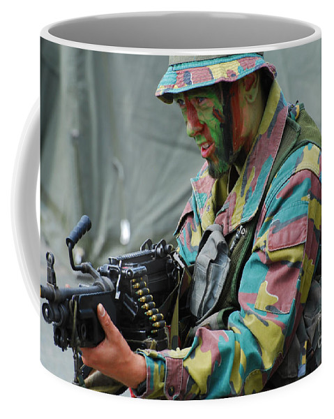 5.56mm Coffee Mug featuring the photograph A Paratrooper Of The Belgian Army by Luc De Jaeger