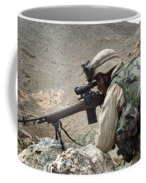 Horizontal Coffee Mug featuring the photograph A Soldier Provides Security by Stocktrek Images
