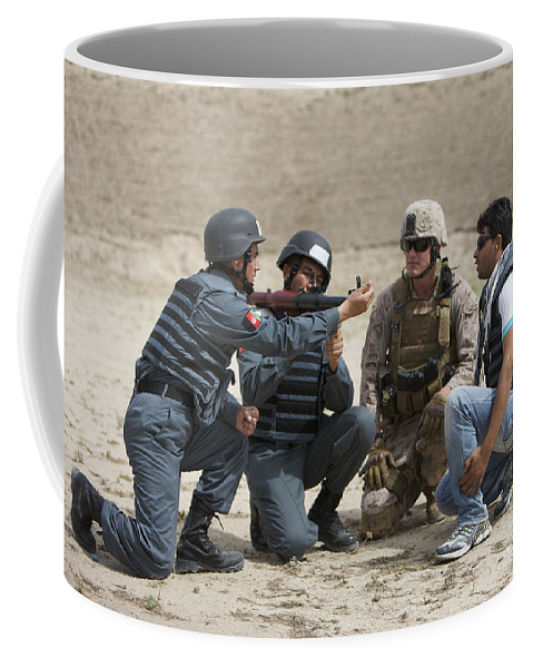 Afghanistan Coffee Mug featuring the photograph An Afghan Police Student Loads A Rpg-7 by Terry Moore