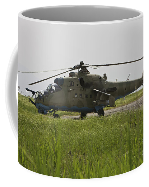 Airfield Coffee Mug featuring the photograph An Mi-35 Attack Helicopter At Kunduz by Terry Moore