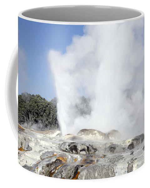Fountain Coffee Mug featuring the photograph Pohutu And Prince Of Wales Feathers by Richard Roscoe