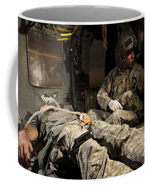 Medical Support Coffee Mug featuring the photograph U.s. Army Specialist Practices Giving by Terry Moore